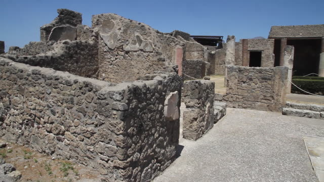 tracking an ancient courtyard in the once buried city of pompeii, napoli - old ruin stock videos & royalty-free footage