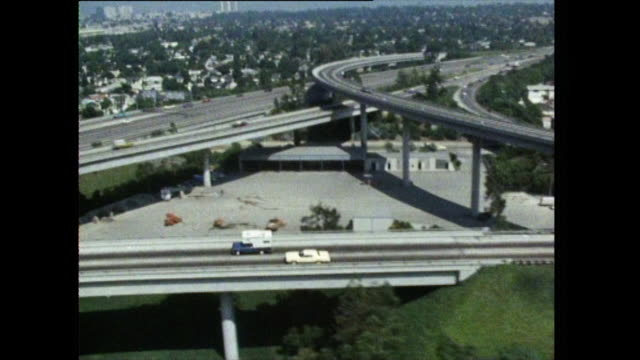 tracking and povs of cars on los angeles freeway; 1972 - autostrada interstatale americana video stock e b–roll