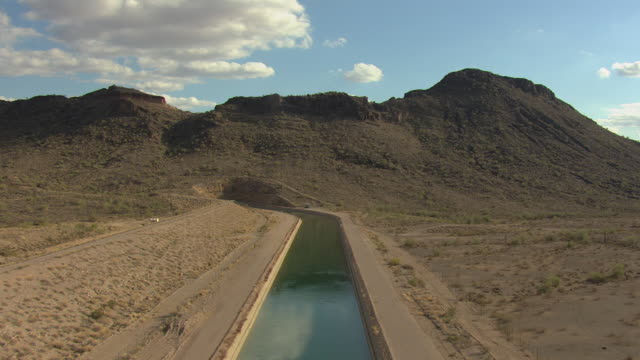 WS AERIAL Tracking aqueduct to Burnt Mountain in Maricopa County / Arizona, United States