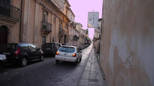 Tracking cars and scooters along the beautiful streets of Noto, Sicily, Italy