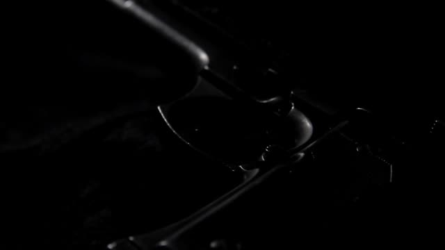 tracking close up of a beretta bruni revolver against black, shallow depth of field - handgun stock videos & royalty-free footage