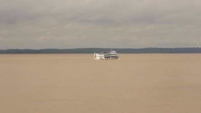 vídeos y material grabado en eventos de stock de tracking long shot riverboat moving across the amazon a transport riverboat travels in the brazilian amazon from maues to manaus on november 27 2013... - amazonas state brazil