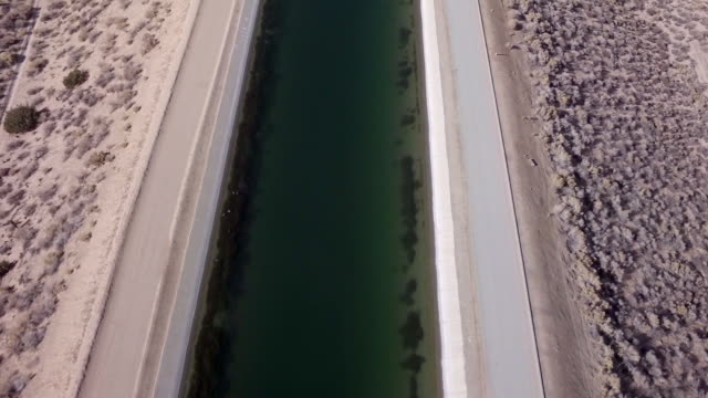 ws aerial tracking over aqueduct in desert - aqueduct stock videos and b-roll footage