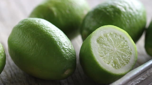 tracking over cut limes  - lime stock videos & royalty-free footage