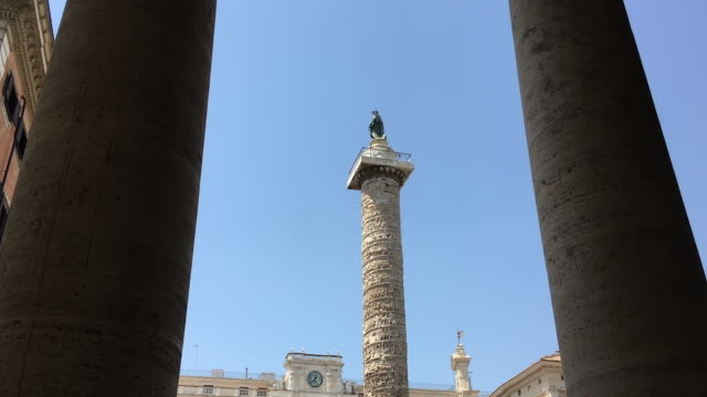 Tracking past colonnades towards the Marcus Aurelius Column honouring the Roman Military, Rome