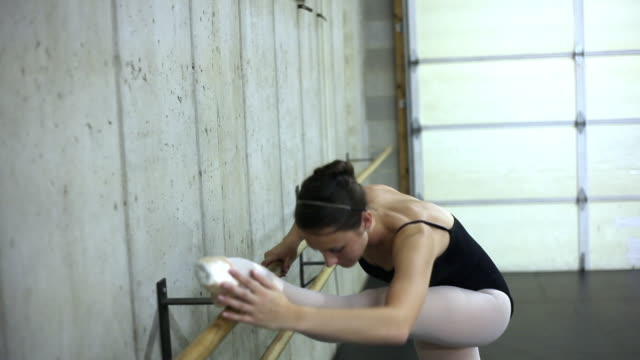 tracking shof of a dancer exercising on a ballet barre. - barre stock videos & royalty-free footage