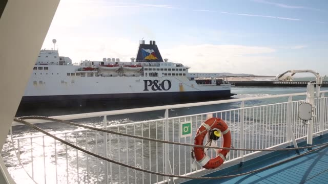 Tracking Shot A 'PO' crosschannel ferry docked in the port of Calais seen from a departing ferry on October 30 2013 in Calais France