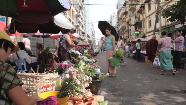 Tracking shot across a street market in Yangon.