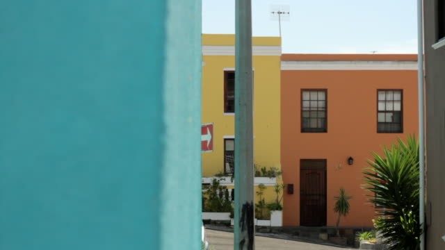 Tracking shot across brightly coloured houses in the Bo-Kaap area of Cape Town.