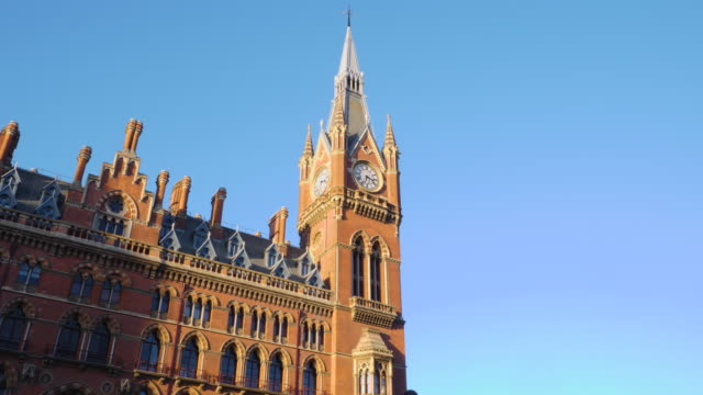 tracking shot across the exterior of the majestic st pancras hotel on london's euston road. - clock face stock videos & royalty-free footage