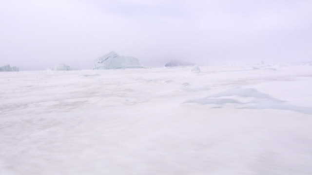 tracking shot across the frozen landscape of qaasuitsup in northwestern greenland.  - frozen stock videos and b-roll footage