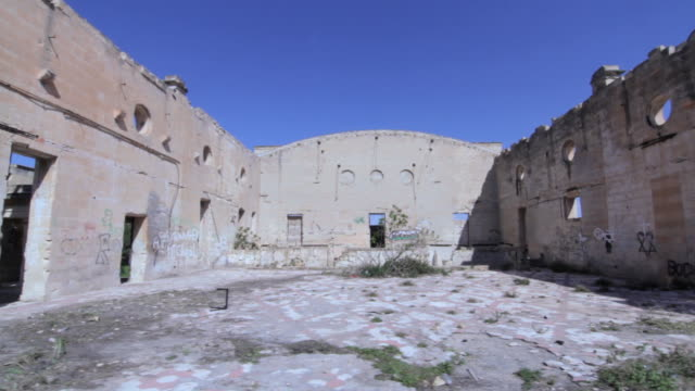 tracking shot across the interior of the derelict australia hall in pembroke, malta. - red cross stock videos & royalty-free footage