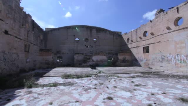 tracking shot across the interior of the derelict australia hall in pembroke, malta. - pembroke video stock e b–roll