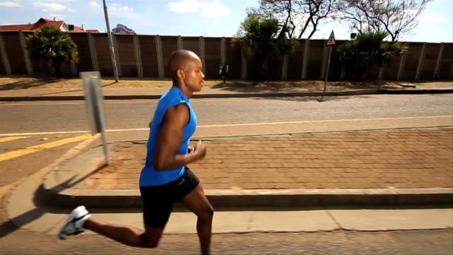 tracking shot african ethnicity male athlete jogging/ pretoria/ south africa - one mid adult man only stock videos & royalty-free footage