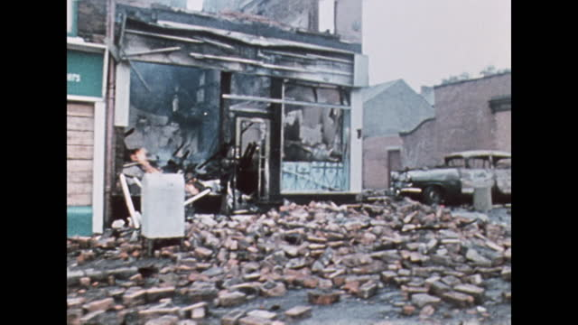 tracking shot along a belfast street with damaged shop fronts after riots; august 1969. - tracking shot stock videos & royalty-free footage