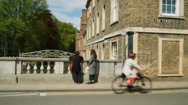 tracking shot along a stone bridge near queen's college, cambridge. - panning stock videos & royalty-free footage