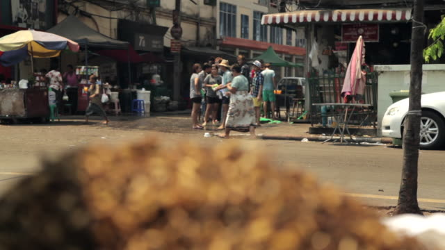 Tracking shot along a street in central Yangon.