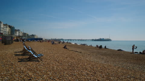 tracking shot along brighton beach, uk. - deckchair stock videos & royalty-free footage