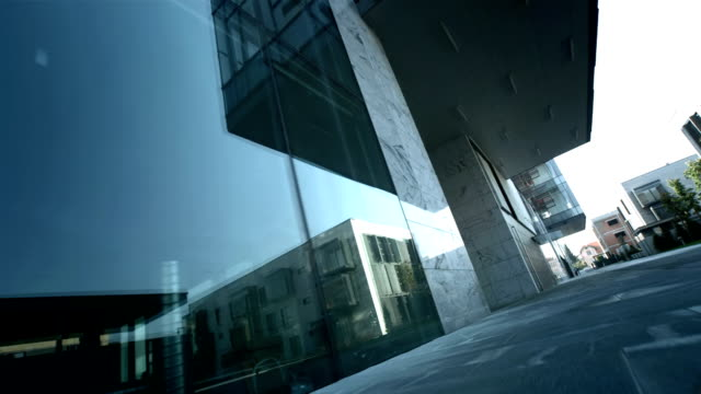 HD: Tracking Shot Along Business Buildings