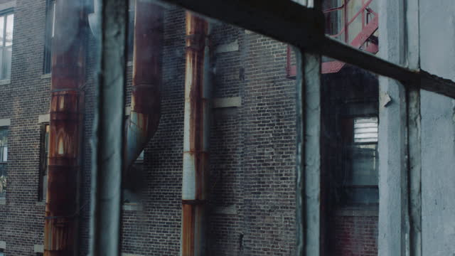 tracking shot along industrial windows - deterioration stock videos & royalty-free footage