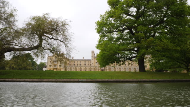 tracking shot along the river cam, moving past the new court of st john's college, cambridge. - cambridge university stock videos & royalty-free footage