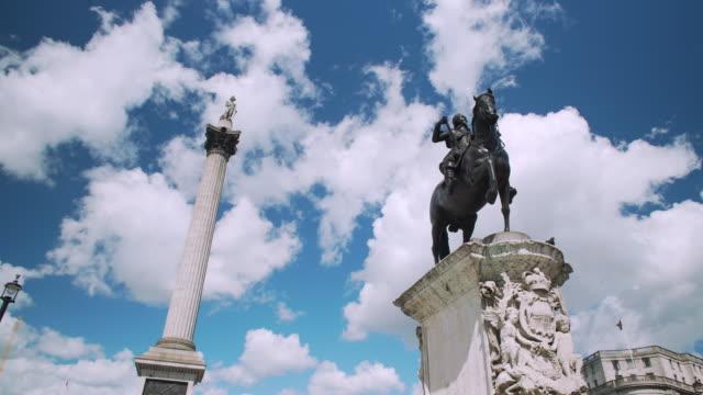 Tracking shot around the statue of Charles I on Trafalgar Square.