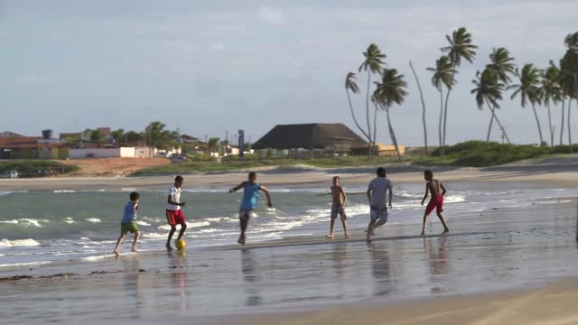 Tracking Shot children playing football on the beach General views from a beach in Natal Brazil shot on December 8th 2014 Natal is located on the...