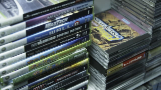 Tracking shot collection of Xbox 360 games close up