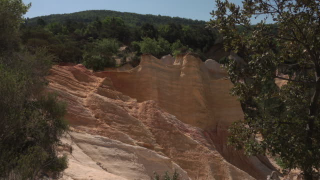 Tracking shot Colorado Provencal canyon with ochre rocks