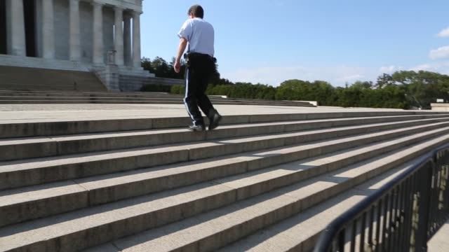 tracking shot, despite being kept about 100 meters back from the lincoln memorial due to the federal government shutdown, tourists continued to visit... - monument stock videos & royalty-free footage
