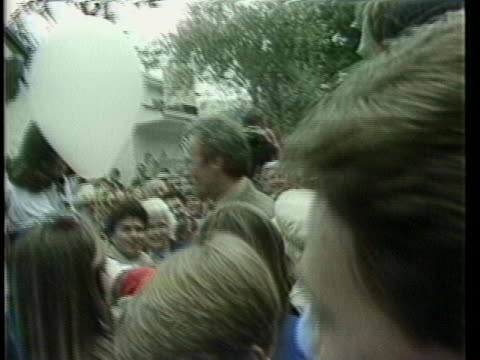 tracking shot eastwood walking walking through crowd of reporters to see eastwood walking by - carmel california stock videos & royalty-free footage