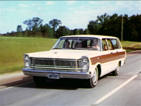 1965 tracking shot family driving ford station wagon on country road / industrial - ford motor company stock videos and b-roll footage