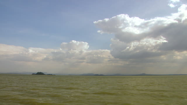 tracking shot from a boat as it travels across lake tana in ethiopia.  - horn of africa stock videos and b-roll footage
