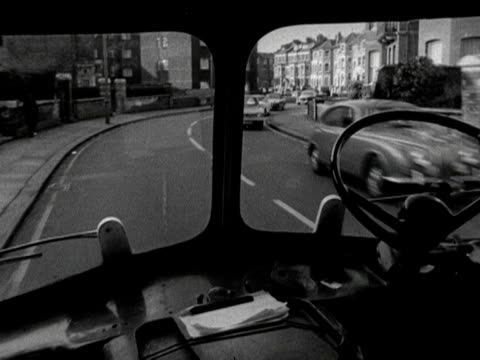 Tracking shot from inside an ambulance as it drives along a road 1968