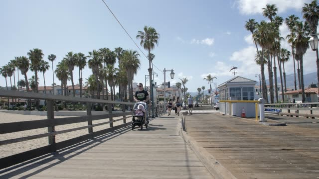 tracking shot from stearns wharf pier and beach, santa barbara, california, united states of america, north america - pier stock videos & royalty-free footage