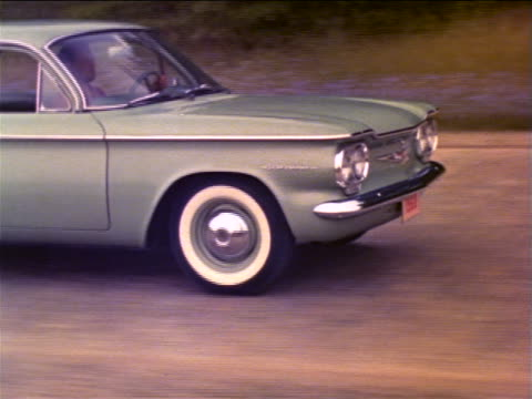 1960 tracking shot front end of corvair driving on rough country road / industrial - general motors stock videos & royalty-free footage