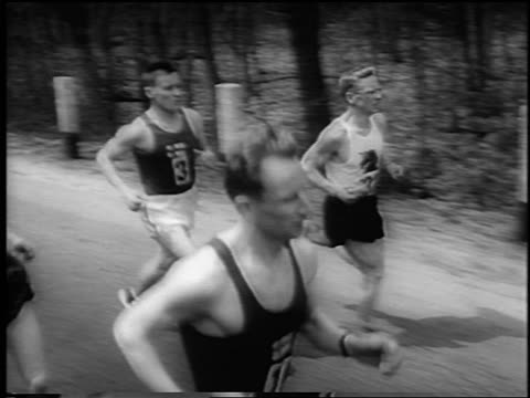 tracking shot front runners leading race in 66th boston marathon / newsreel - 1962年点の映像素材/bロール