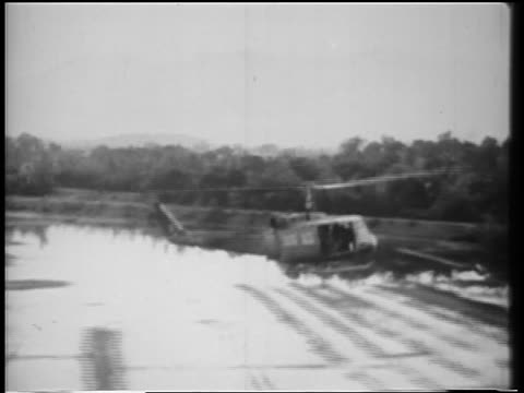 air tracking shot helicopter flying over rice paddies in vietnam war - air to air shot stock videos & royalty-free footage