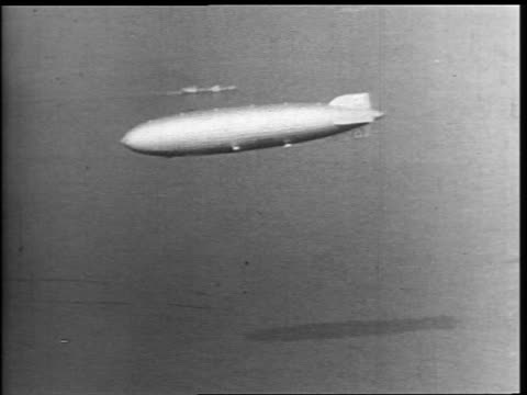 tracking shot hindenburg flying over ocean - 1937 stock videos & royalty-free footage