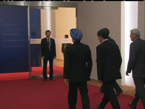 indian prime minister manmohan singh gets out of limo motions to camera then heads down red carpeted hallway - business or economy or employment and labor or financial market or finance or agriculture stock videos & royalty-free footage
