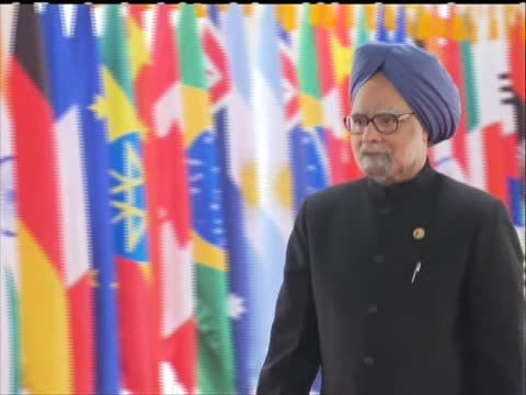 indian prime minister manohan singh walks down red carpet upon arrival at the g20 summit in south korea. - (war or terrorism or election or government or illness or news event or speech or politics or politician or conflict or military or extreme weather or business or economy) and not usa stock videos & royalty-free footage