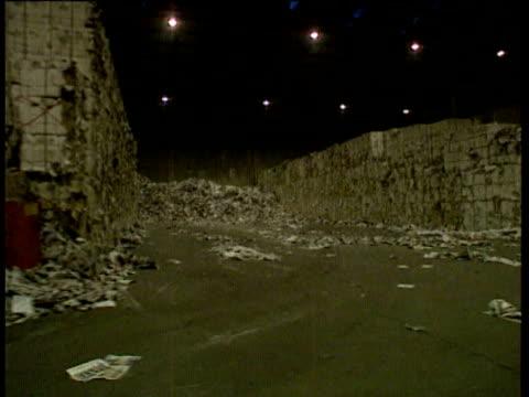 tracking shot inside waste paper warehouse / recycling. paper recycling warehouse on november 11, 1993 - warehouse点の映像素材/bロール