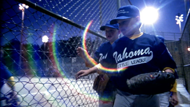 tracking shot little league baseball team leaving bench and running onto field / seattle, washington - youth baseball and softball league stock videos and b-roll footage