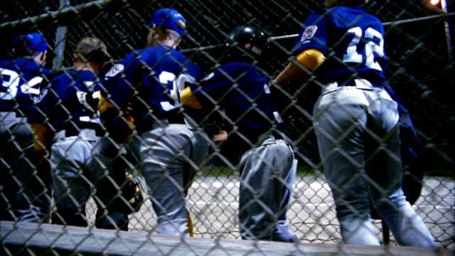 tracking shot little league baseball team running onto field / coach cheering / seattle, washington - little league stock videos and b-roll footage