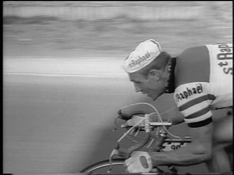 tracking shot male cyclist racing in tour de france / newsreel - tour de france stock videos & royalty-free footage