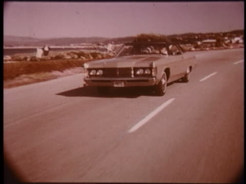 1970 tracking shot mercury monterey driving on coastal highway - ford motor company stock videos and b-roll footage