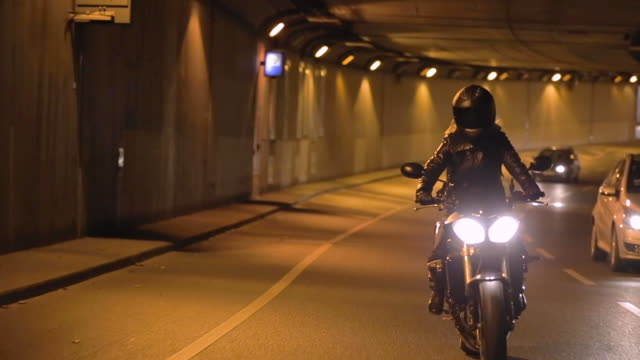 tracking shot, motorcycle drives through tunnel in berlin - leder stock-videos und b-roll-filmmaterial