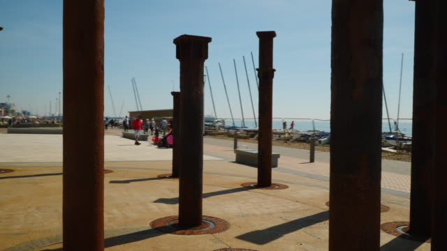 Tracking shot moving around the old support pillars of Brighton's derelict West Pier.