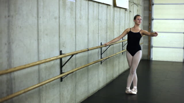 tracking shot of a ballerina in rehearsal. - barre stock videos & royalty-free footage
