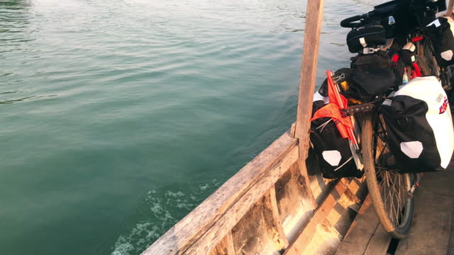 Tracking shot of a bicycle leaning on the moving taxi boat